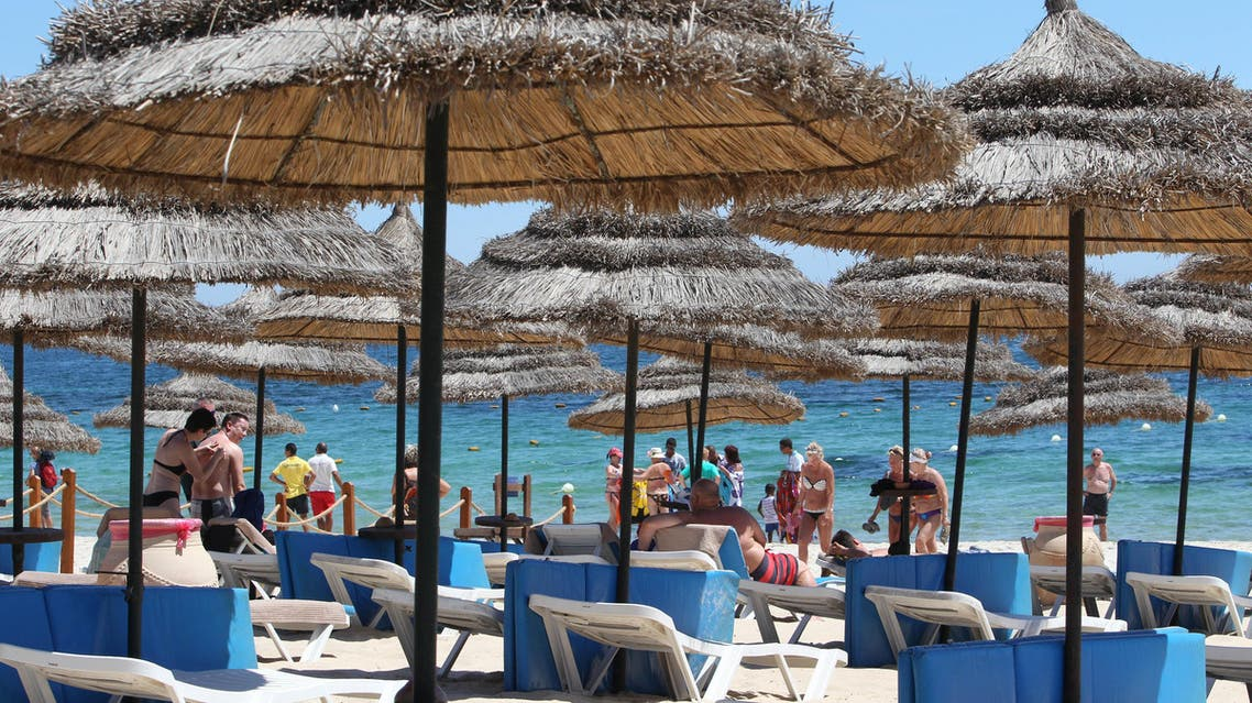 Tourists sunbathe at the Mediterranean resort of Sousse, Tunisa, four days after Friday's terrorist attack, Tuesday, June 30, 2015. One of Tunisia's top security officials says the gunman who killed 38 tourists, mostly Britons, in a beach attack was trained in neighboring Libya at the same time as the attackers who targeted the Bardo museum in March. (AP)
