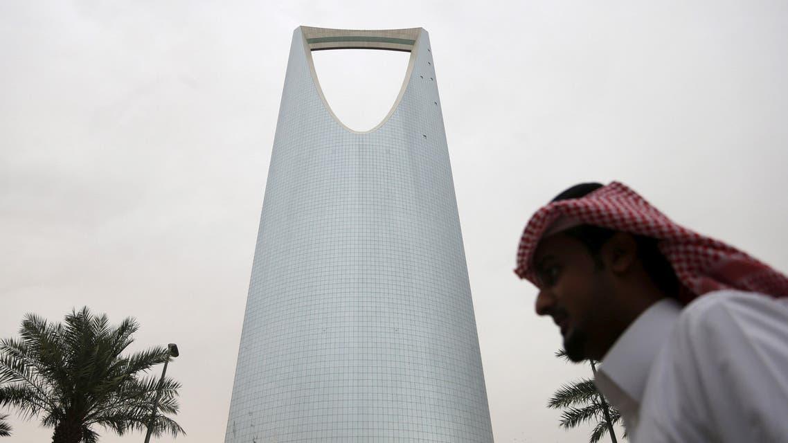 A man walks past the Kingdom Centre Tower in Riyadh, Saudi Arabia April 12, 2016. reuters