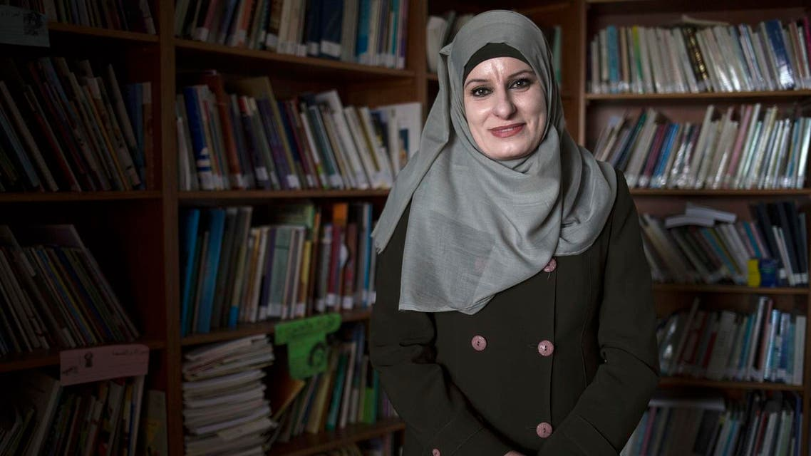 One divorce at a time, Reema Shamasneh fights for female clients in an Islamic family court where a man's testimony is worth twice a woman's. (AP)