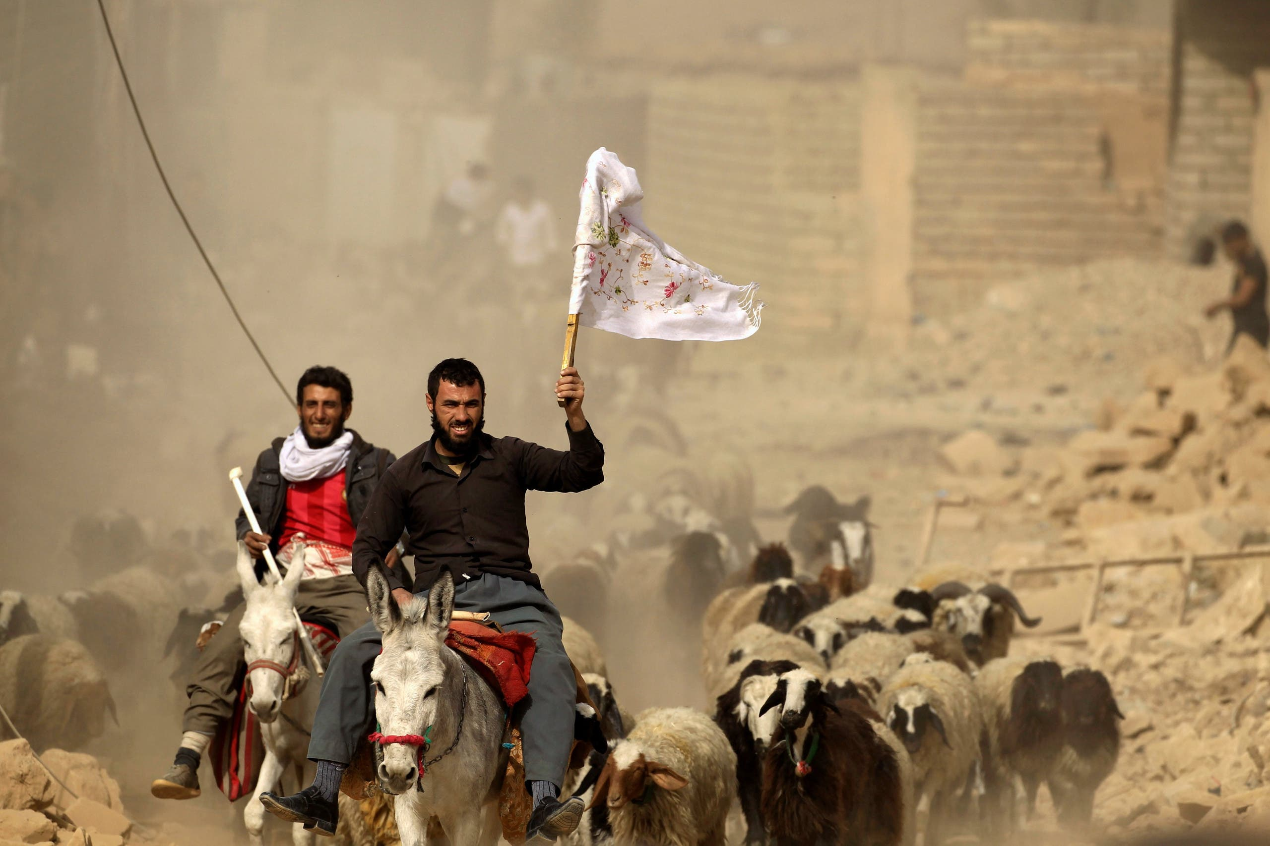 Civilians raise white flags as Mosul operation continues