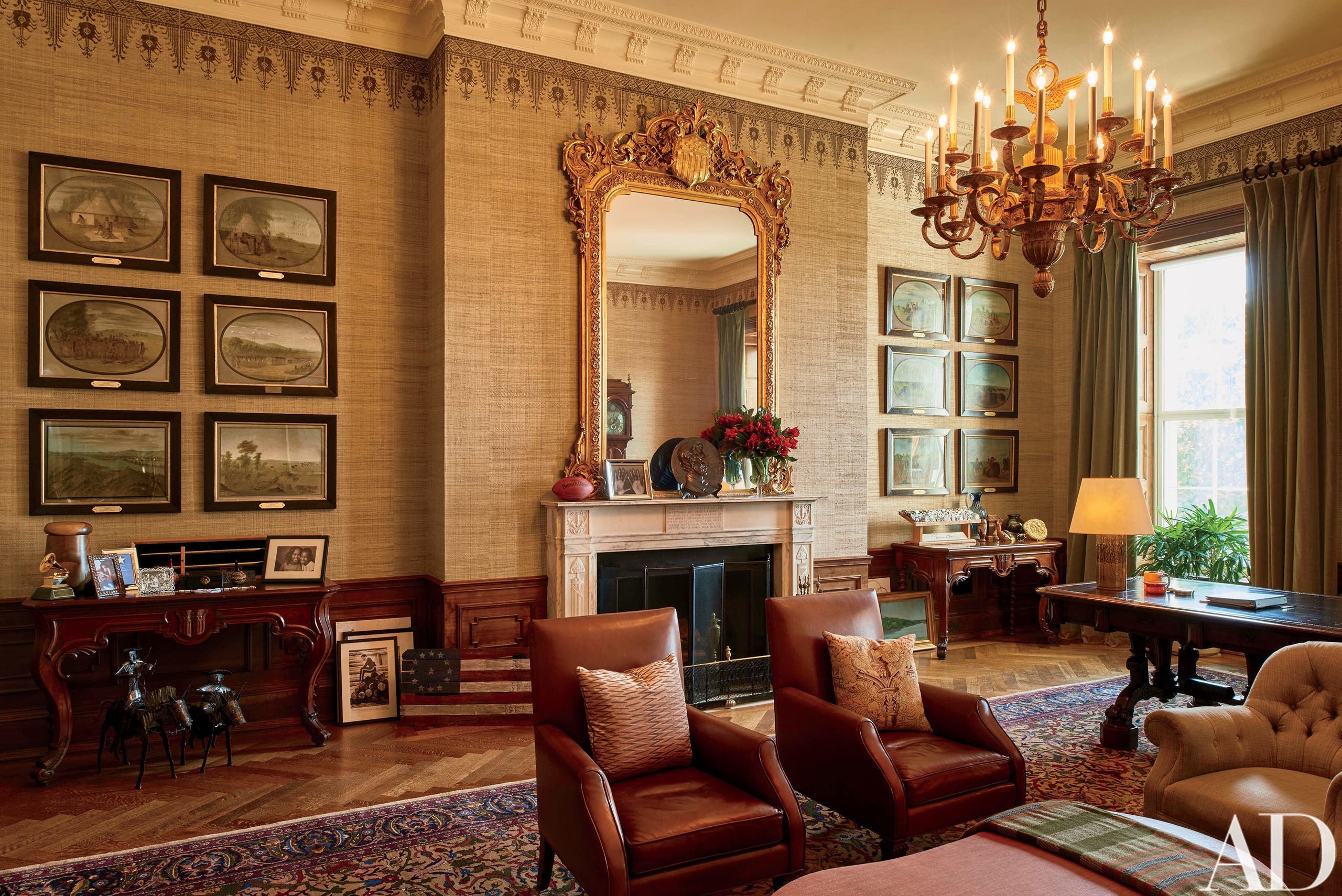 """This image provided by Architectural Digest shows The Treaty Room in the White House in Washington in August 2016. The Treaty Room is filled with memorabilia including one of President Barack Obama's two Grammy Awards, family photos, and a personalized football. It's also where Obama often retreats late at night. He uses the room's namesake table, which has been in the White House since 1869, as a desk. Obama likes to say the White House is the """"people's house."""" The Architectural Digest photos are giving the public its first glimpse of private areas on the second floor of the White House that Obama, his wife, Michelle, daughters Malia and Sasha and family dogs Bo and Sunny have called home for nearly eight years.(Michael Mundy/Architectural Digest via AP)"""