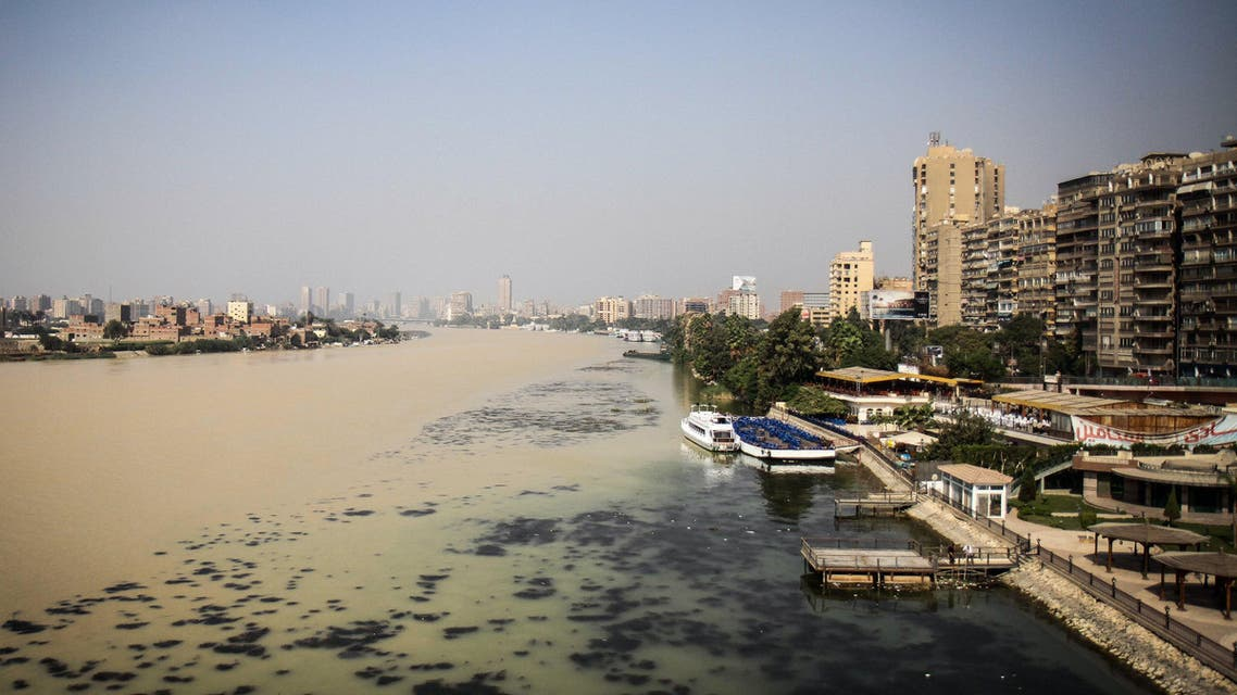 A picture taken on October 31, 2016 in Cairo shows yellow-brown water in a section of the Nile River caused by excess silt from recent floods in the southern Egyptian provinces. AFP