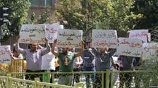 إيران.. احتجاجات أمام البرلمان تزامناً مع حضور روحاني