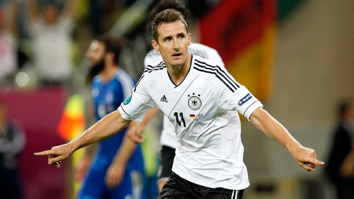 Germany's Miroslav Klose celebrates scoring his side's third goal during the Euro 2012 soccer championship quarterfinal match between Germany and Greece in Gdansk, Poland, Friday, June 22, 2012. (AP)