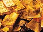 الذهب يهبط بضغط من ارتفاع الدولار ومخاوف رفع الفائدة