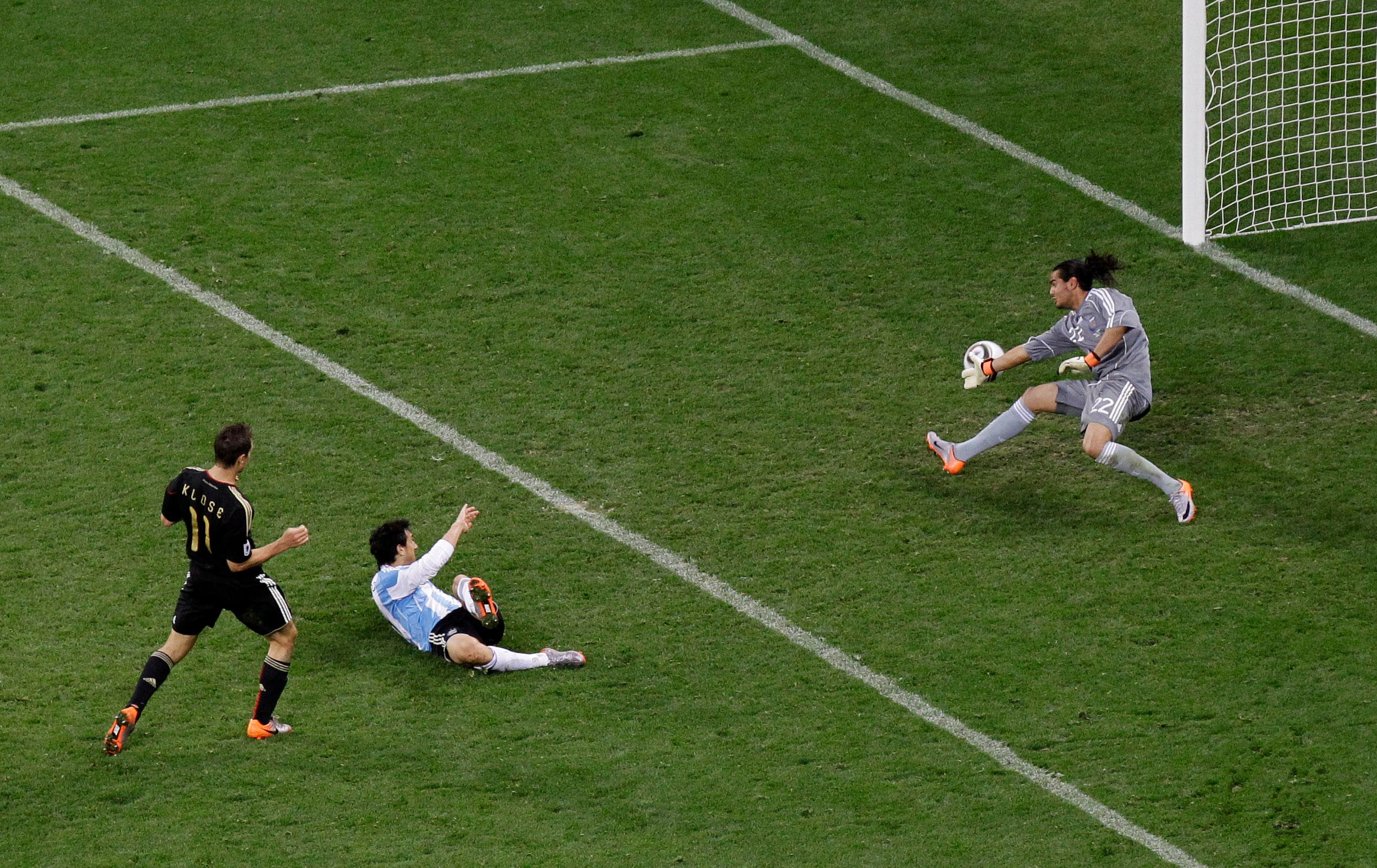 Germany's Miroslav Klose, left, scores his side's fourth goal past Argentina goalkeeper Sergio Romero, right, during the World Cup quarterfinal soccer match between Argentina and Germany at the Green Point stadium in Cape Town, South Africa, Saturday, July 3, 2010. Germany won 4-0. (AP)