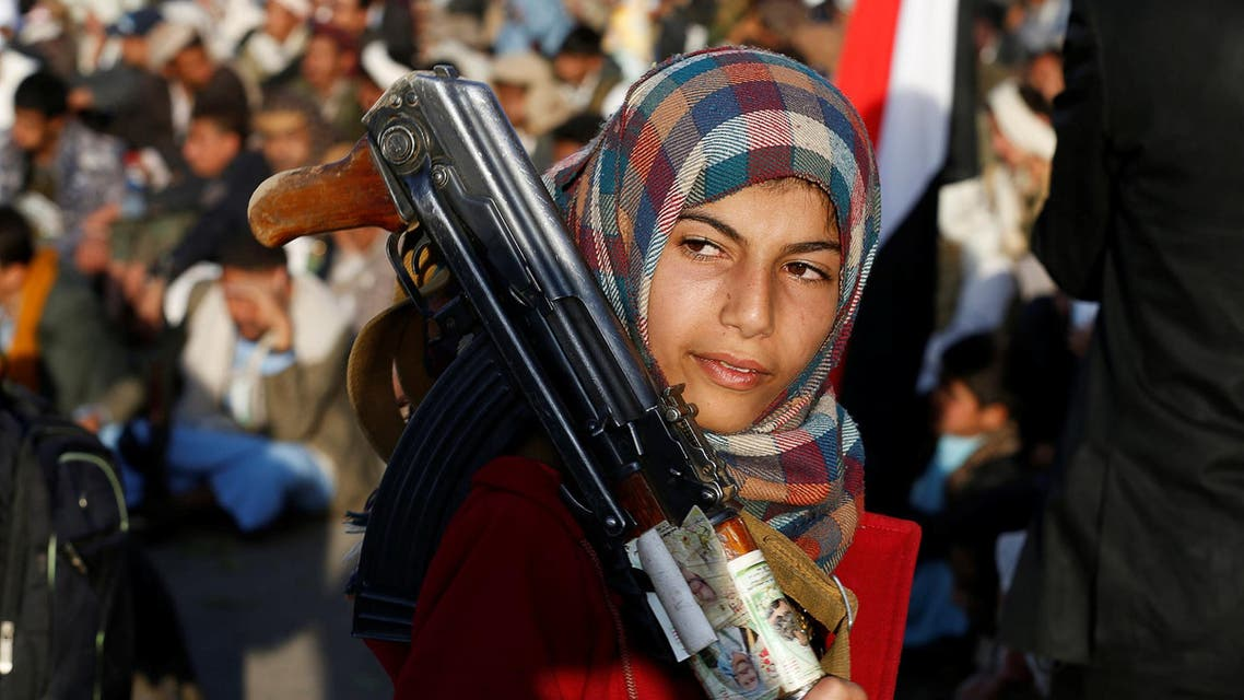 A girl carries a rifle as she attends a rally by followers of the Shi'ite Houthi movement commemorating the death of Imam Zaid bin Ali in Sanaa, Yemen October 26, 2016. REUTERS