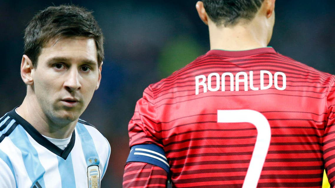 Lionel Messi of Argentina, left, stands next to Cristiano Ronaldo of Portugal before their International Friendly soccer match at Old Trafford Stadium, Manchester, England, Tuesday Nov. 18, 2014. (AP