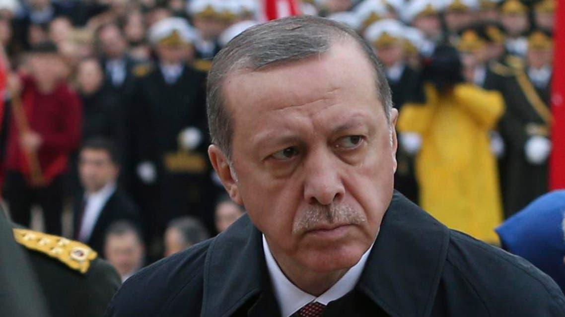Turkish President Recep Tayyip Erdogan, center, follows a military honour guard walking to the mausoleum of Turkey's founder Mustafa Kemal Ataturk on Republic Day in Ankara, Turkey, Saturday, Oct. 29, 2016. (AP Photo/Burhan Ozbilici)