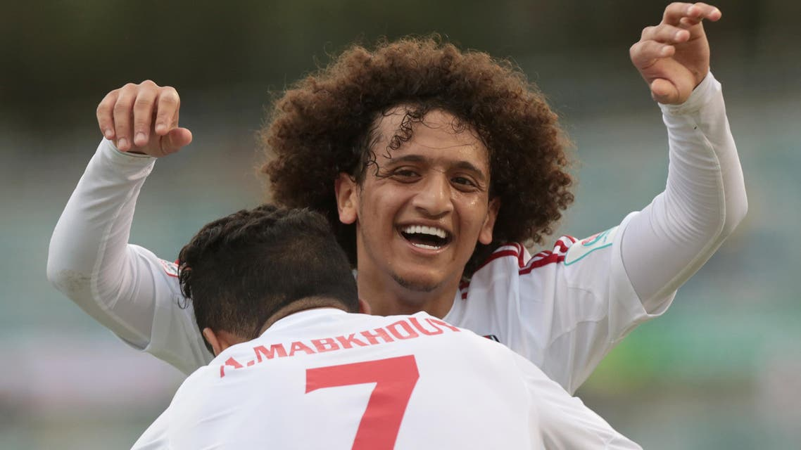 UAE's Ali Ahmed Mabkhout is embraced by teammate Omar Abdulrahman, right, after scoring his second goal during their first round soccer match of the AFC Asia Cup between the United Arab Emirates and Qatar in Canberra, Australia, Sunday, January 11, 2015. (AP Photo/Andrew Taylor)