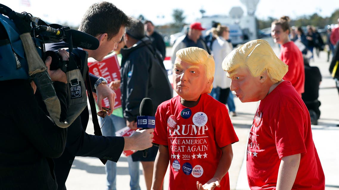 Two young Donald Trump supporters are interviewed by a television reporter before a campaing rally for Republican presidential candidate Donald Trump Saturday, Nov. 5, 2016, in Wilmington, N.C. (AP