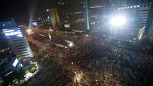 Tens of thousands protest in South Korea, call for president to quit