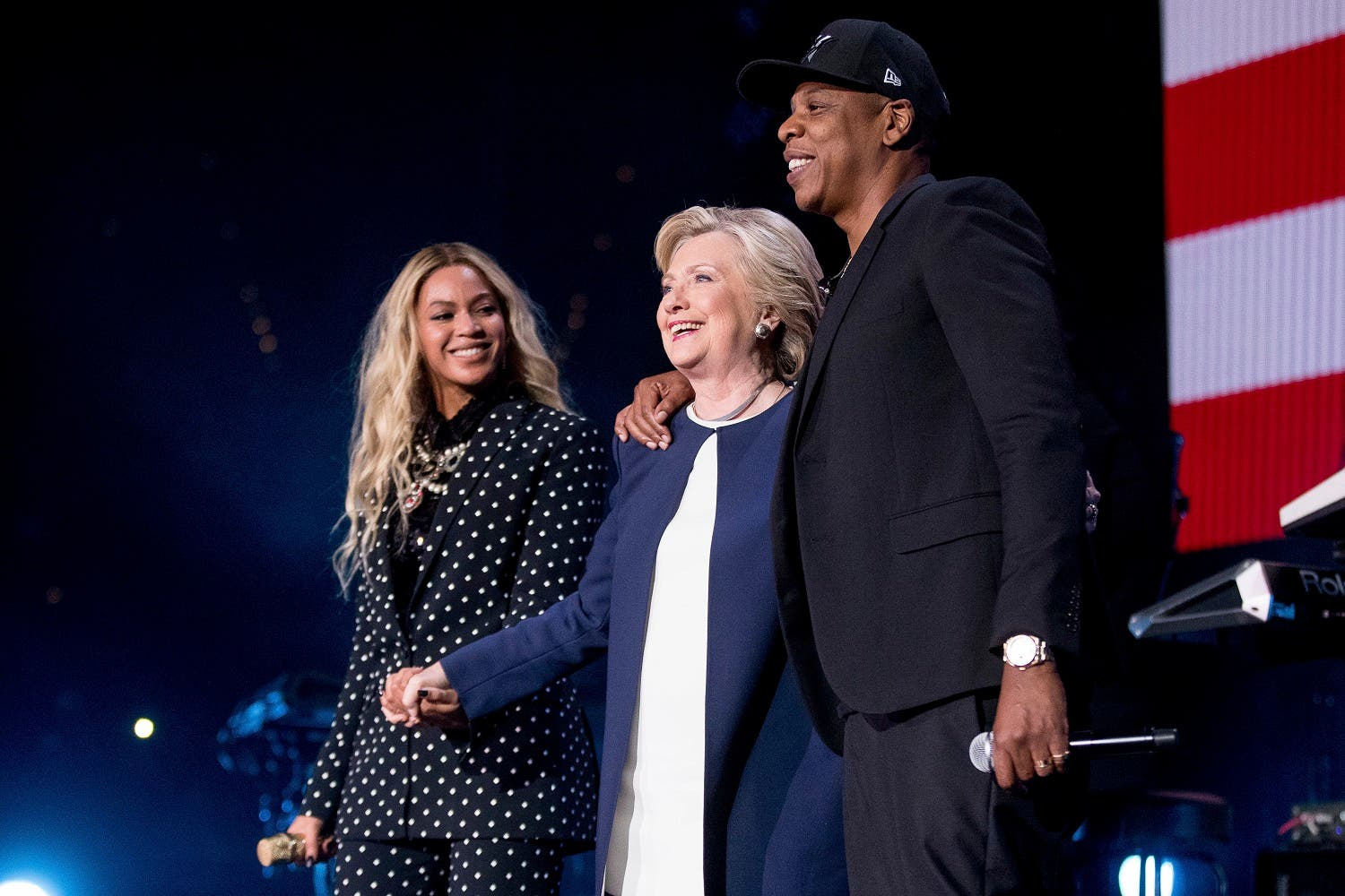 AP Democratic presidential candidate Hillary Clinton, center, appears on stage with artists Jay Z, right, and Beyonce, left, during a free concert at at the Wolstein Center in Cleveland, Friday, Nov. 4, 2016.