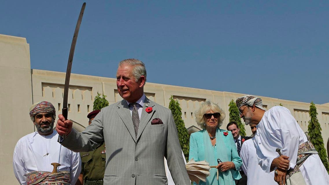 Britain's Prince Charles dances with a sword with a group of Omani traditional dancers in Muscat, Oman. (AP)