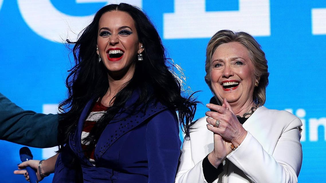 Democratic presidential nominee former Secretary of State Hillary Clinton (R) appears on stage with recording artist Katy Perry (L) during a get-out-the-vote concert at the Mann Center for the Performing Arts on November 5, 2016 in Philadelphia, Pennsylvania. (AFP)