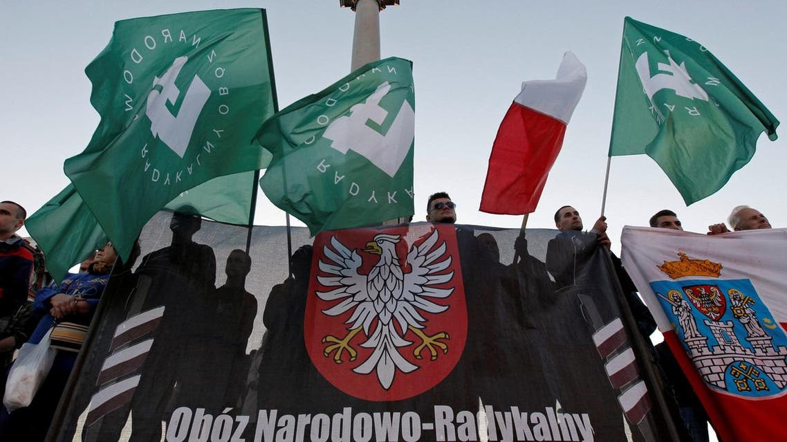 People hold flags with the Falanga symbol as they take part in the march held by far-right organizations in Warsaw, Poland September 21, 2013. Reuters