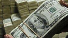 الدولار يهبط بعد إعلان المركزي عن رفع تدريجي للفائدة