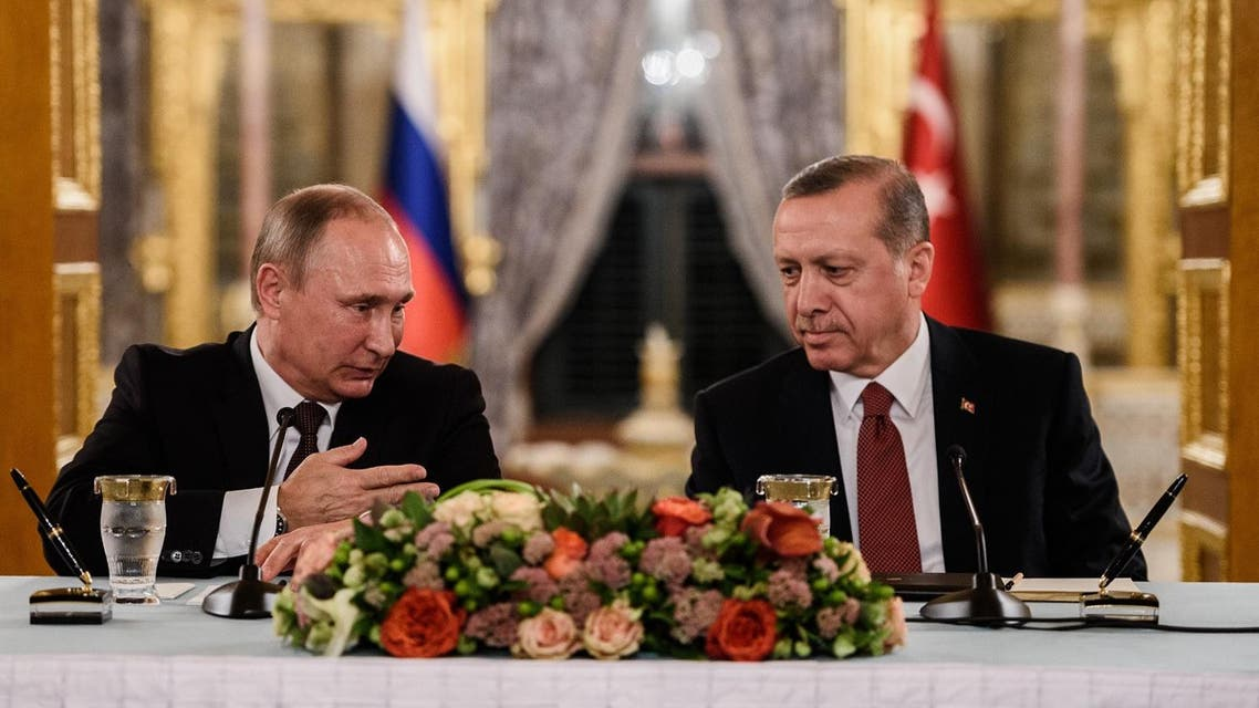 Russian President Vladimir Putin (L) speaks to Turkish President Recep Tayyip Erdogan (R) as they attend a press conference on October 10, 2016 in Istanbul. Putin visits Turkey on October 10 for talks with counterpart Recep Tayyip Erdogan, pushing forward ambitious joint energy projects as the two sides try to overcome a crisis in ties. OZAN KOSE / AFP