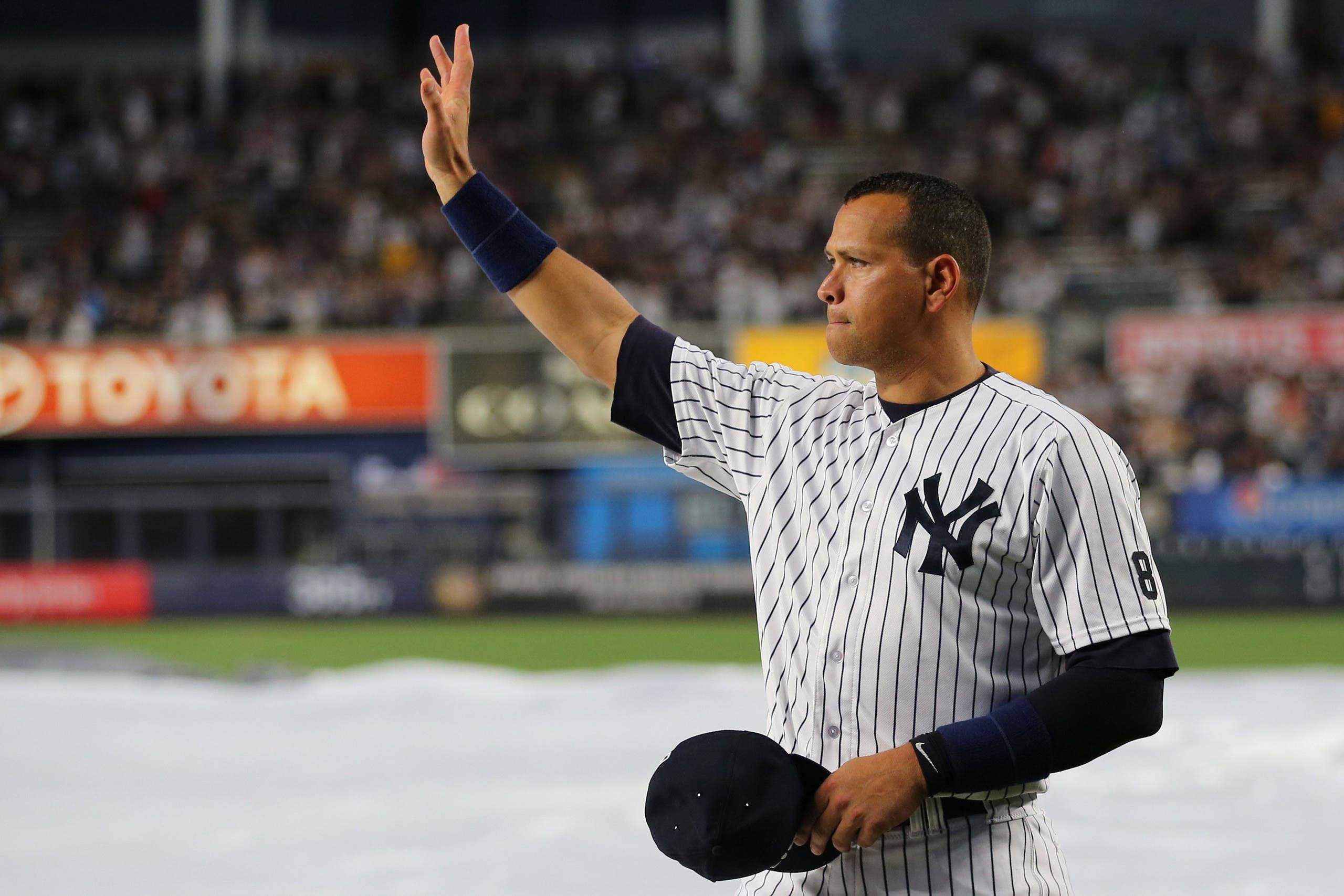 New York Yankees designated hitter Alex Rodriguez (13) acknowledges the crowd before his last game as a Yankee against the Tampa Bay Rays at Yankee Stadium. Mandatory Credit: Anthony Gruppuso-USA TODAY Sports