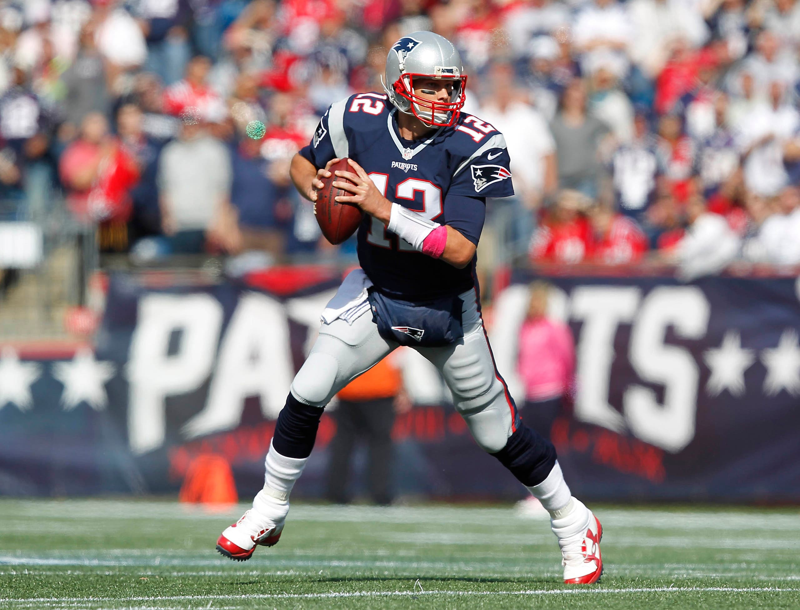 New England Patriots quarterback Tom Brady (12) scrambles out of the pocket during the first quarter against the Cincinnati Bengals at Gillette Stadium. Mandatory Credit: Stew Milne-USA TODAY Sports