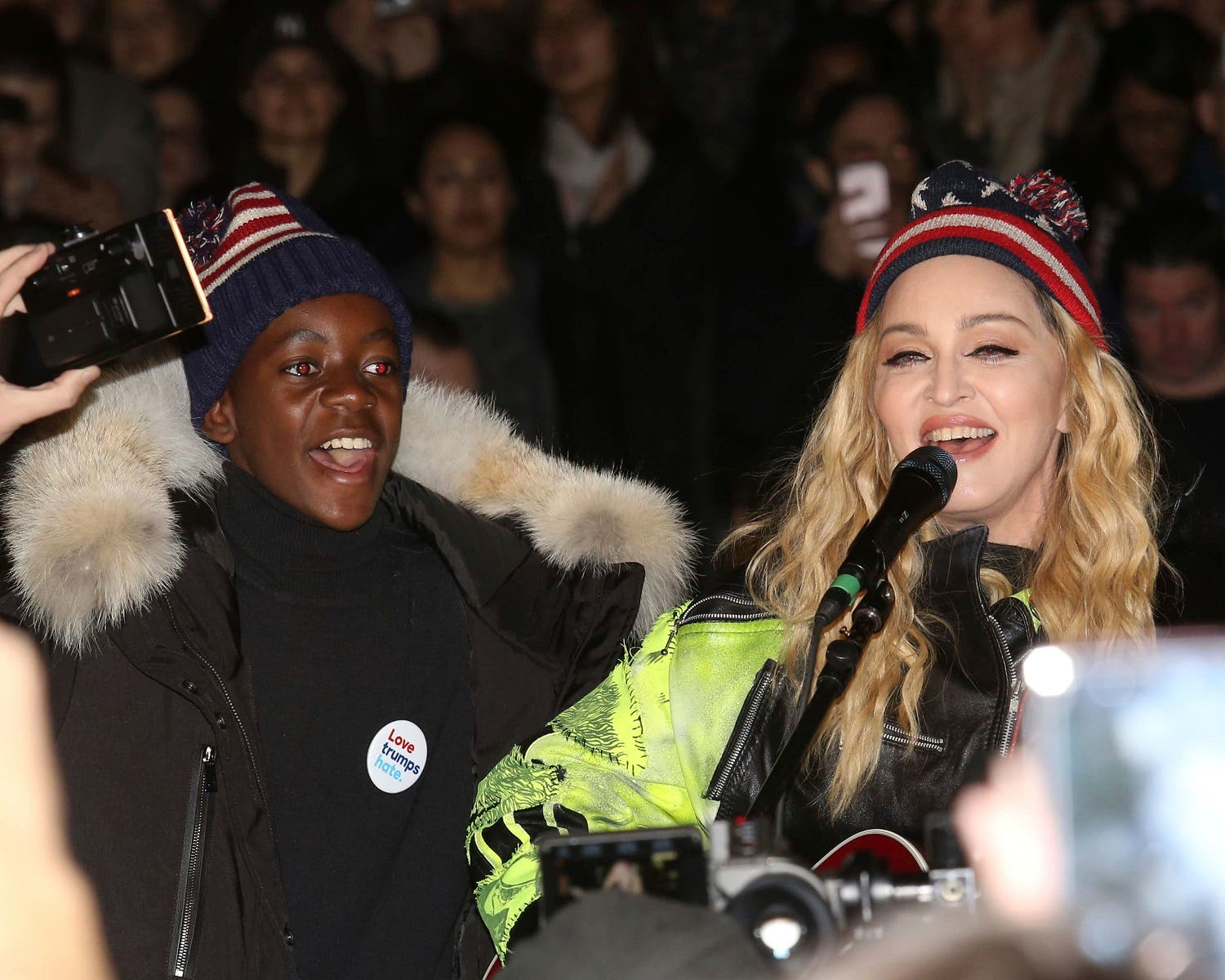 Madonna, right, and her son David Banda perform in support of the Hillary Clinton campaign at Washington Square Park on Monday, Nov. 7, 2016, in New York. (AP)