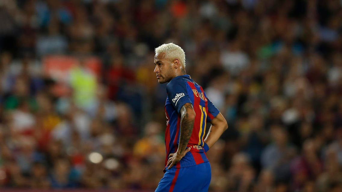FC Barcelona's Neymar pauses during the Spanish La Liga soccer match between FC Barcelona and Atletico Madrid at the Camp Nou in Barcelona, Spain, Wednesday, Sept. 21, 2016. (AP