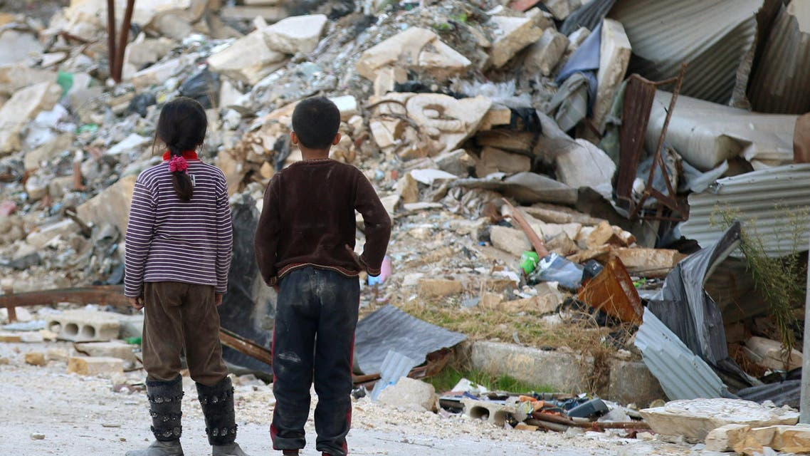 Children inspect rubble of damaged buildings in a rebel-held besieged area in Aleppo, Syria November 6, 2016. reuters