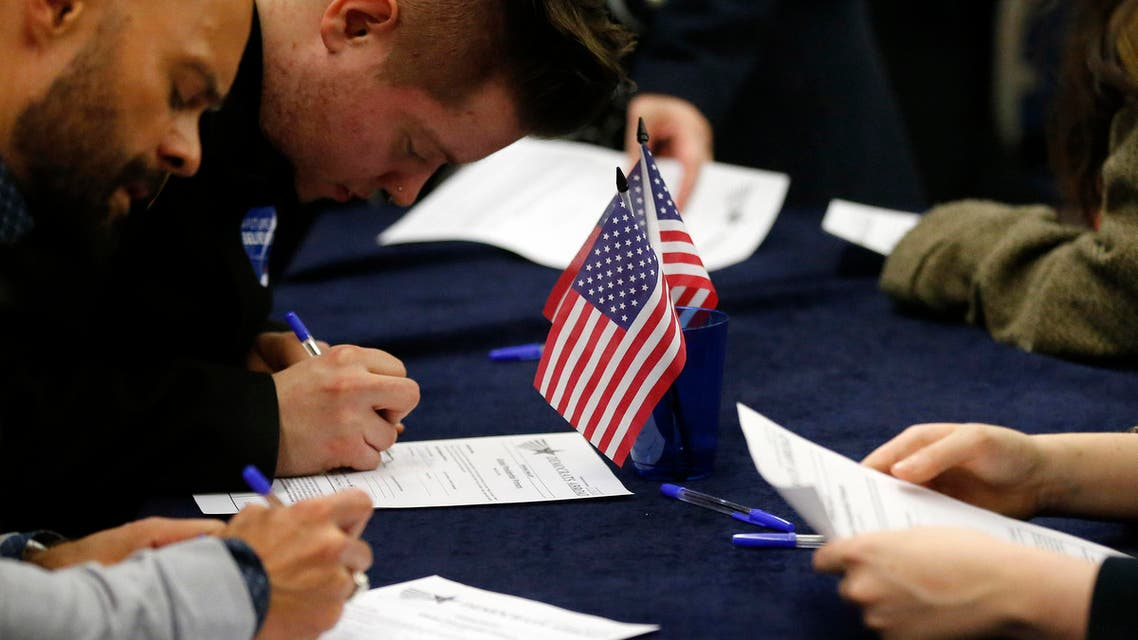 Voters fill out their ballot paper in London, Tuesday, March 1, 2016 as voting begins in the U.S. Democrats Abroad Global Presidential Primary.(AP)