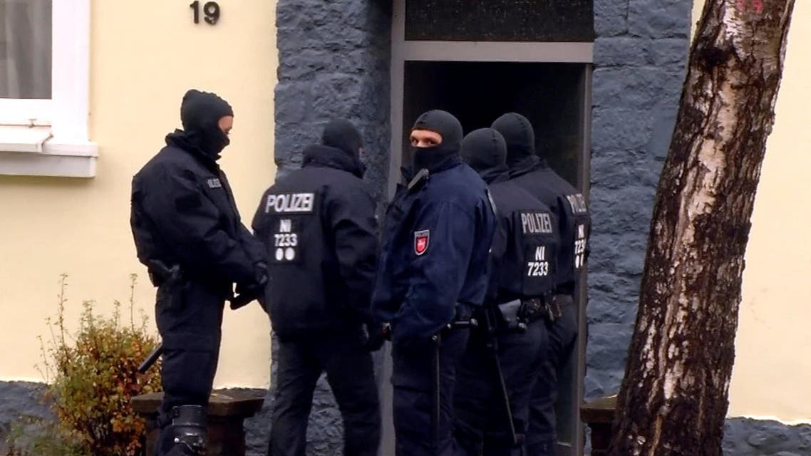 A still image taken from video shows German special police forces standing in front of a house opposite a building with a Muslim prayer room in Hildesheim, Germany, November 8, 2016. reuters