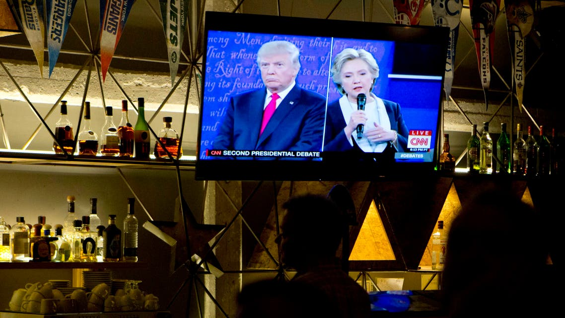 In this file photo dated Sunday, Oct. 9, 2016, The second U.S. presidential debate between Republican presidential candidate Donald Trump, left, and Democratic presidential candidate Hillary Clinton is shown on a TV screen at a restaurant in Mexico City. AP