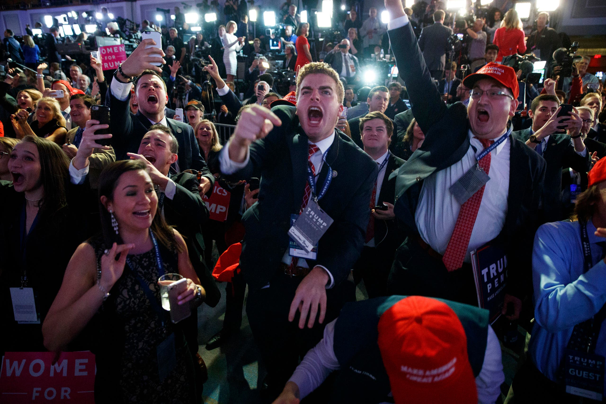 Supporters of Republican presidential candidate Donald Trump cheer as they watch election returns during an election night rally, Tuesday, Nov. 8, 2016, in New York. (AP)