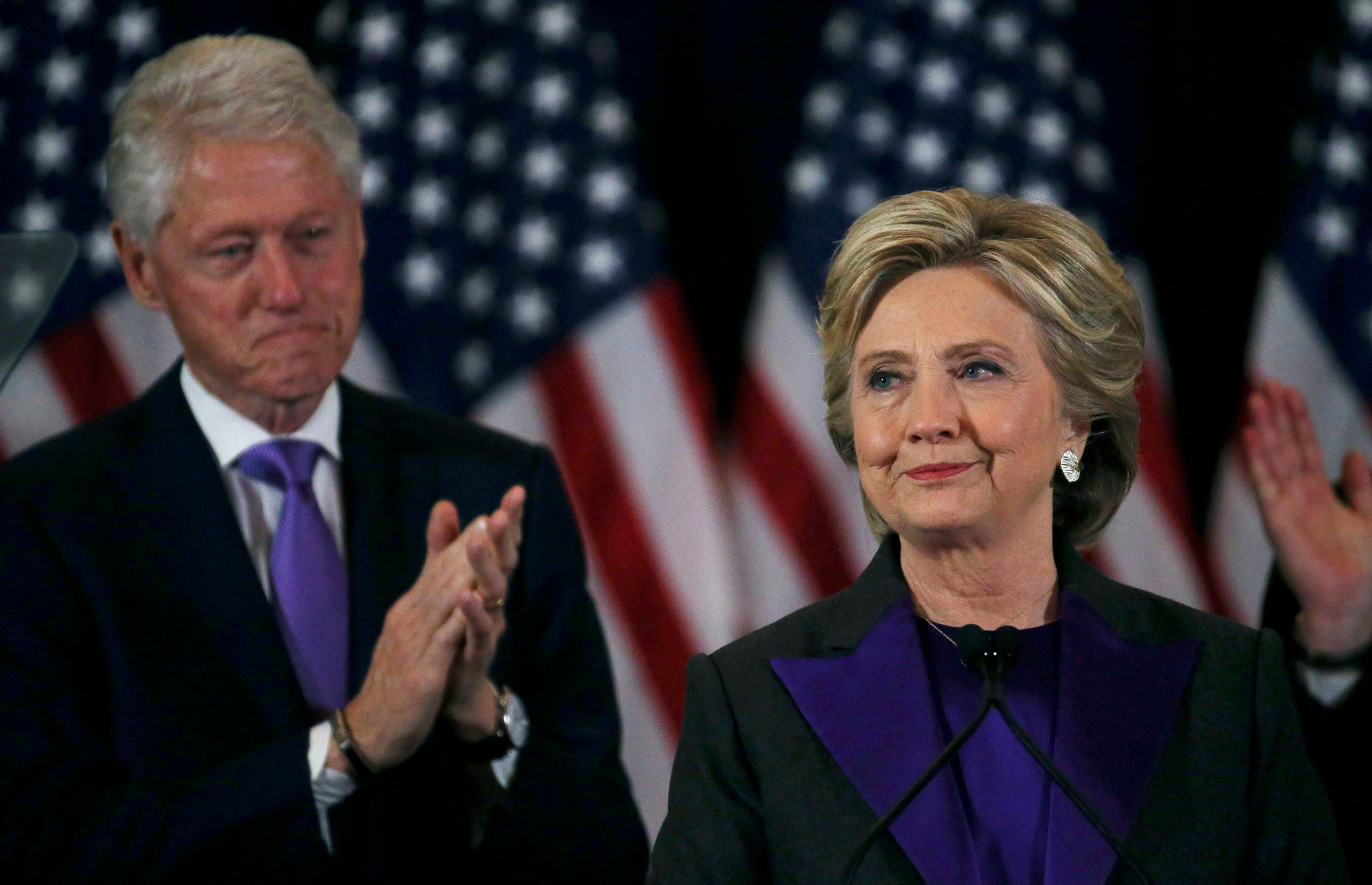 Hillary Clinton, accompanied by her husband former U.S. President Bill Clinton (L), addresses her staff and supporters about the results of the U.S. election at a hotel in New York, November 9, 2016.