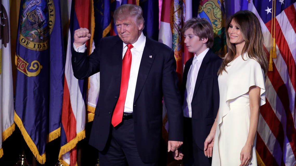 President-elect Donald Trump pumps his fist after giving his acceptance speech as his wife Melania Trump, right, and their son Barron Trump follow him during his election night rally, Wednesday, Nov. 9, 2016, in New York. AP
