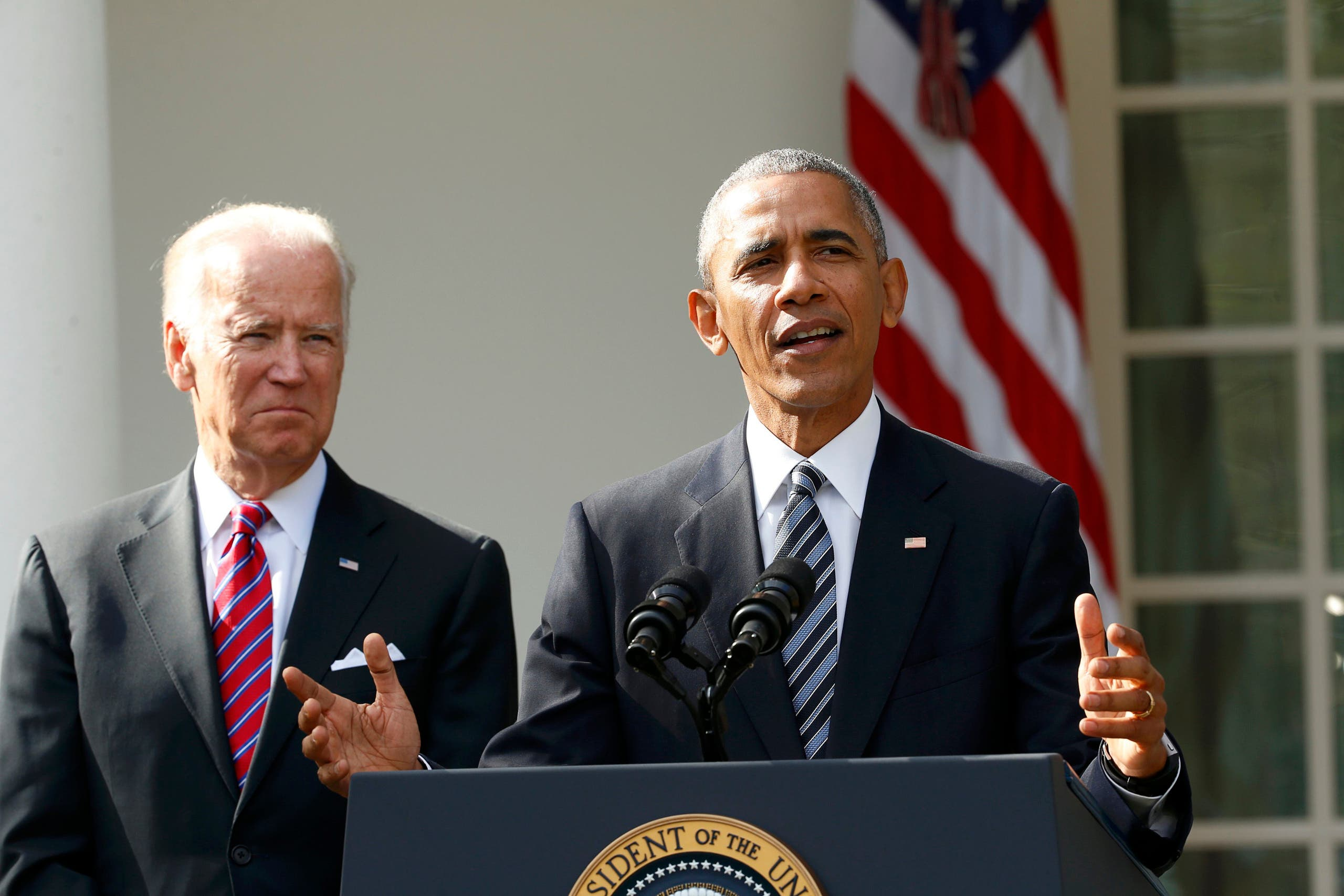 President Barack Obama, with VP Joe Biden at his side (L), delivers a statement from the White House, Nov. 9, 2016. (Reuters)