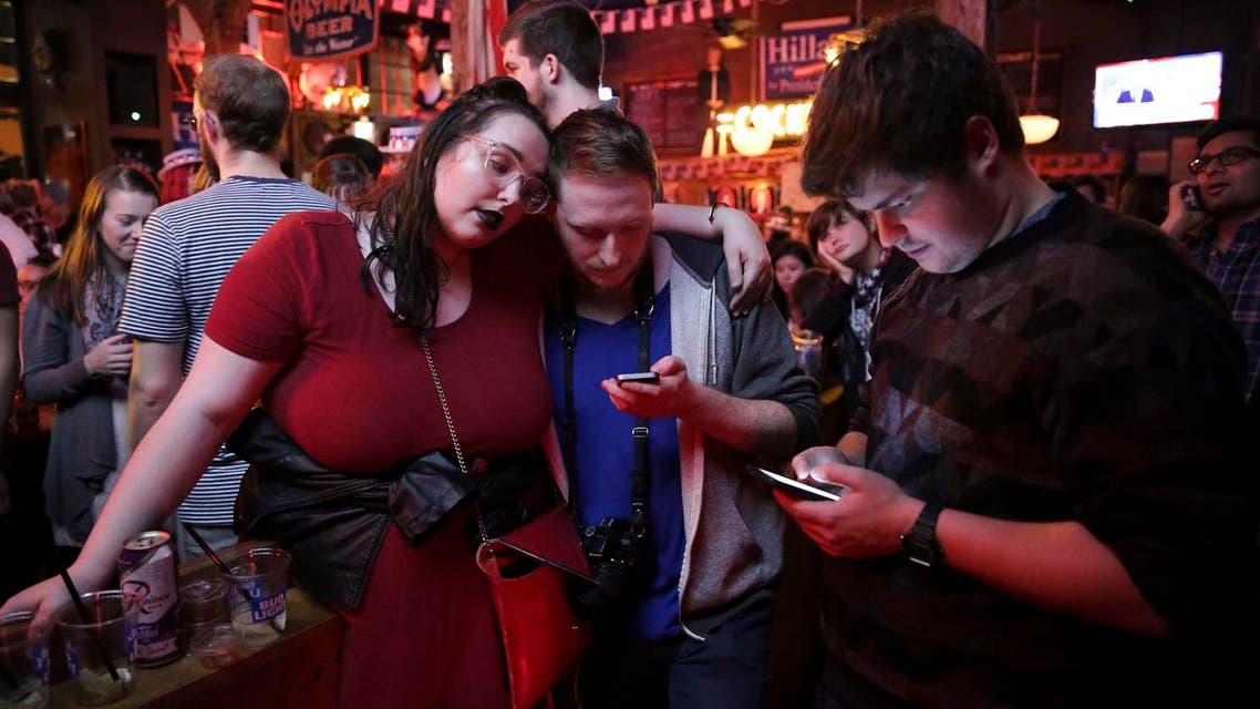 Supporters of US Democratic presidential candidate Hillary Clinton watch televised coverage of the US presidential election at Comet Tavern in the Capitol Hill neighborhood of Seattle, Washington, on November 8, 2016. Jason Redmond / AFP