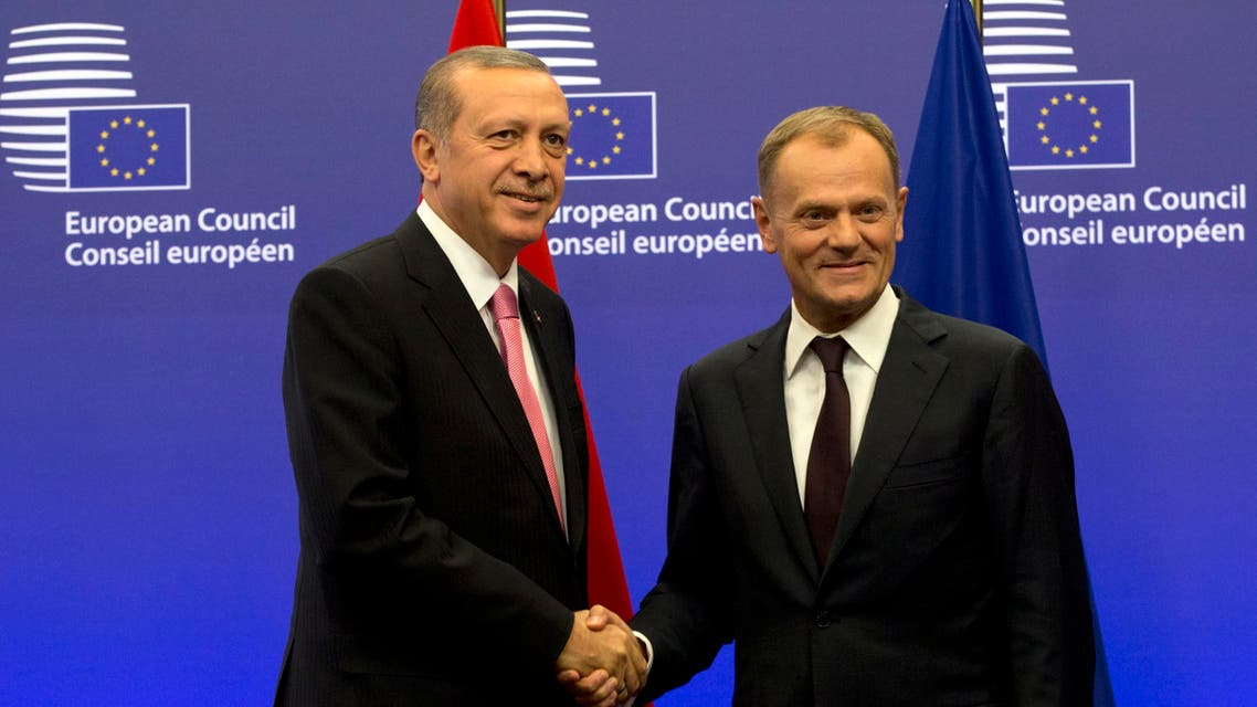 Turkish President Recep Tayyip Erdogan, left, is greeted by European Council President Donald Tusk prior to a meeting at the EU Council building in Brussels on Monday, Oct. 5, 2015. AP