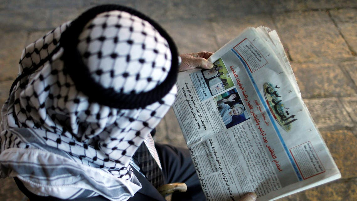 A Palestinian man reads the Al-Quds newspaper depicting images newly elected U.S. President Donald Trump and Democratic presidential nominee Hillary Clinton in Jerusalem's Old City November 9, 2016. reuters