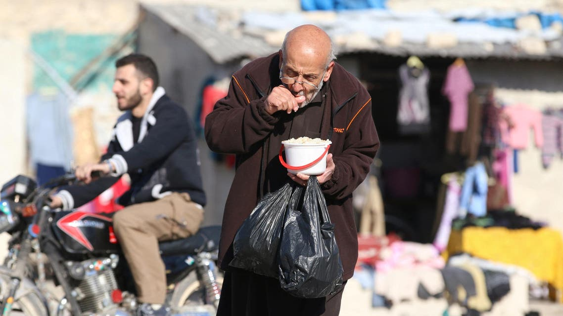 A man eats food that was distributed as aid in a rebel-held besieged area in Aleppo, Syria November 6, 2016