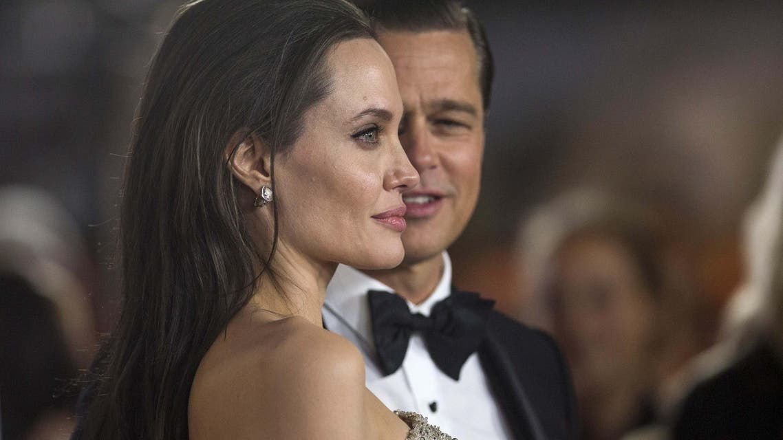 """Angelina Jolie and Brad Pitt pose at the premiere of """"By the Sea"""" during the opening night of AFI FEST 2015 in Hollywood, California, U.S., Nov. 5, 2015. (Reuters)"""