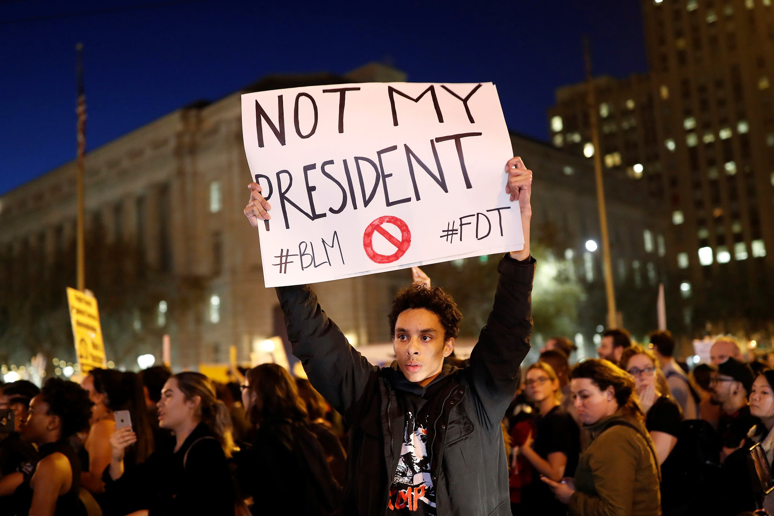A demonstrator holds a sign during a protest in San Francisco, California, US following the election of Donald Trump as the president of the United States November 9, 2016. (Reuters)