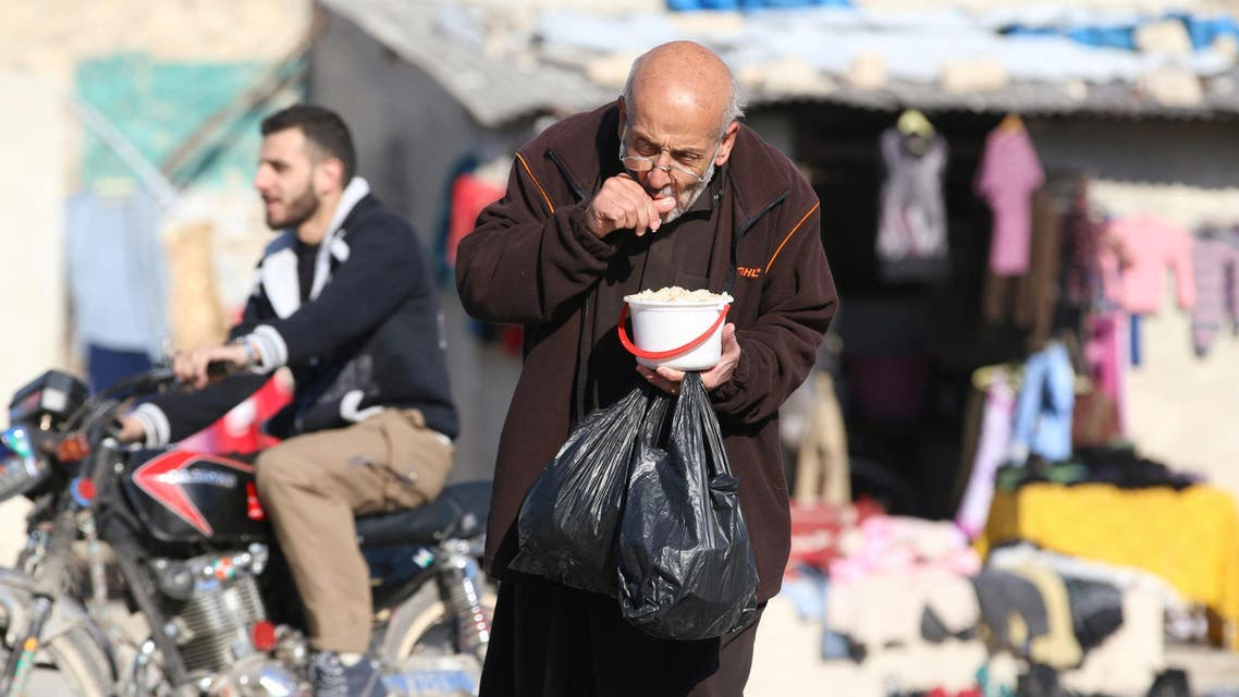 A man eats food that was distributed as aid in a rebel-held besieged area in Aleppo, Syria November 6, 2016. (Reuters)