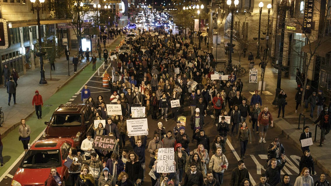 Anti-Trump demonstrators protest on November 9, 2016 in Chicago, Illinois. (AFP)