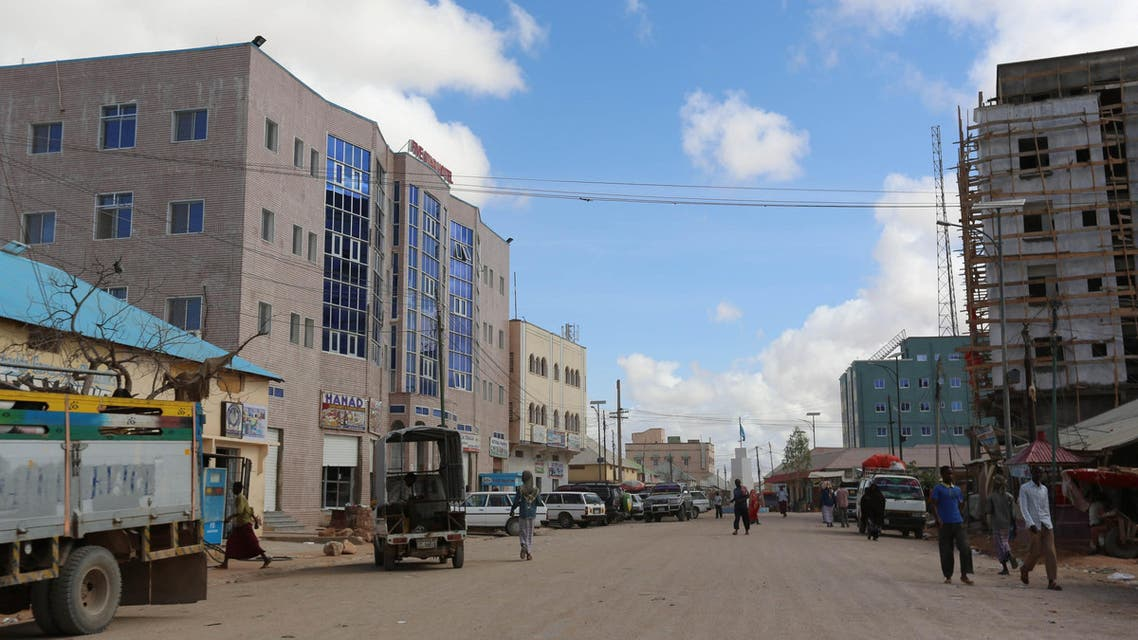 A general view shows people walking along a street in Galkayo, a city divided between the semi-autonomous regions of Puntland and Galmudug, in central Somalia