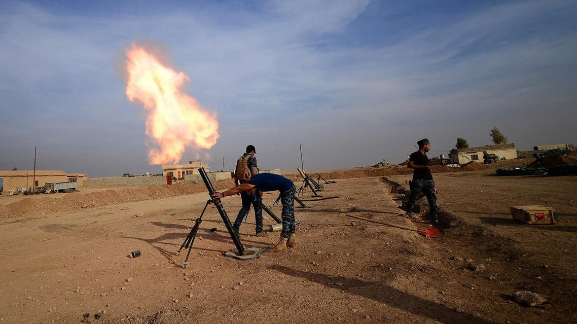 Federal police forces fire mortar toward ISIS militants south of Mosul. (Reuters)