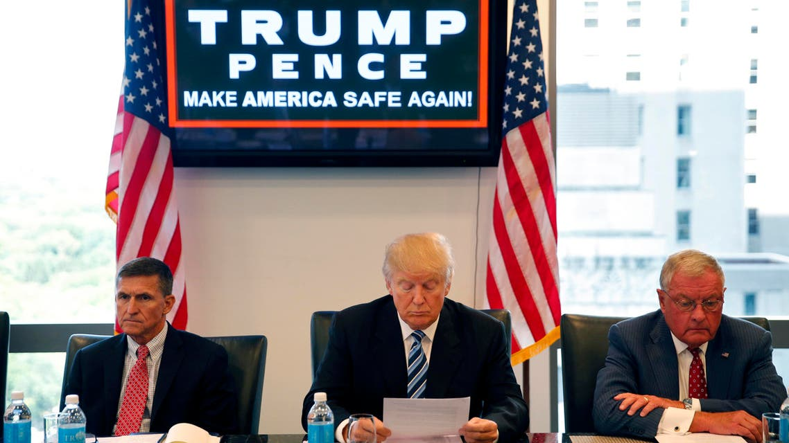 In this Aug. 17, 2016, file photo, then-Republican presidential candidate Donald Trump participates in a roundtable discussion on national security in his offices in Trump Tower in New York, with Ret. Army Gen. Mike Flynn, left, Ret. Army Lt. Gen. Keith Kellogg. (AP)