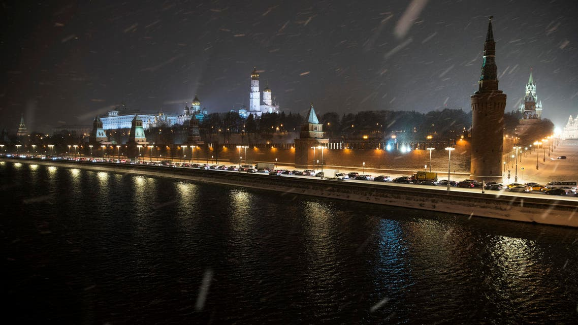 Cars stand in a traffic jam along the embankment of the Moskva River outside the Kremlin during snowfall in Moscow, Russia, Friday, Nov. 11, 2016. AP