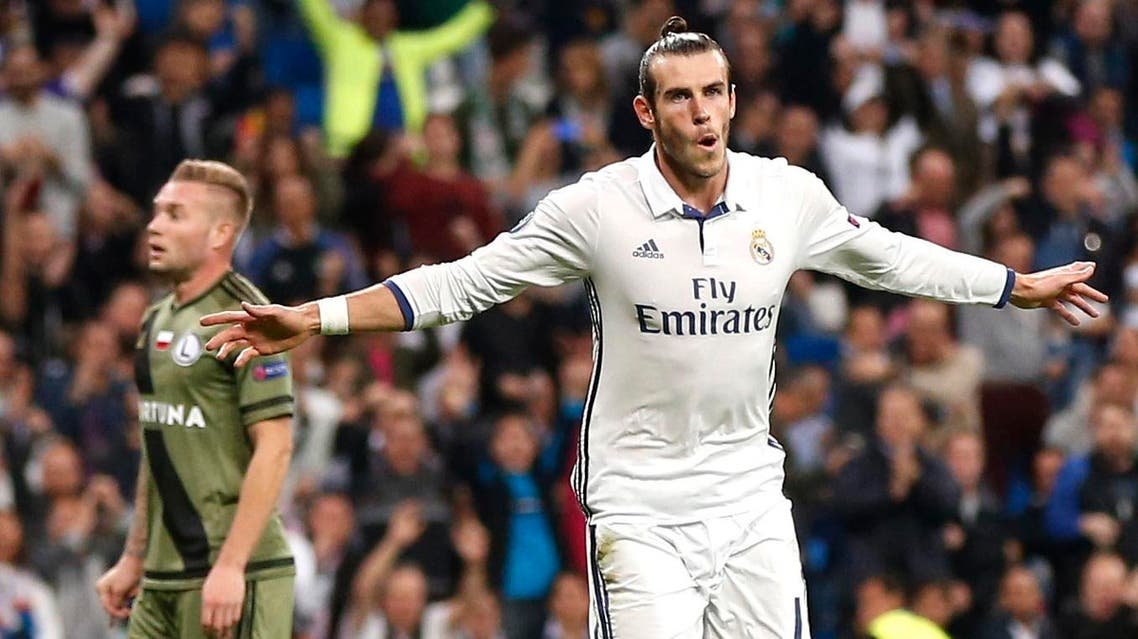 Real Madrid's Gareth Bale celebrates scoring the opening goal during a Champions League, Group F soccer match between Real Madrid and Legia Warsaw, at the Santiago Bernabeu stadium in Madrid, Tuesday, Oct. 18, 2016. (AP)