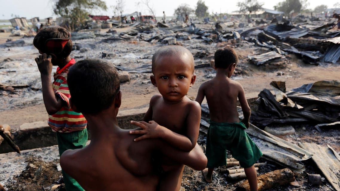 Boys stand among debris after fire destroyed shelters at a camp for internally displaced Rohingya Muslims in the western Rakhine State near Sittwe, Myanmar May 3, 2016. (Reuters)