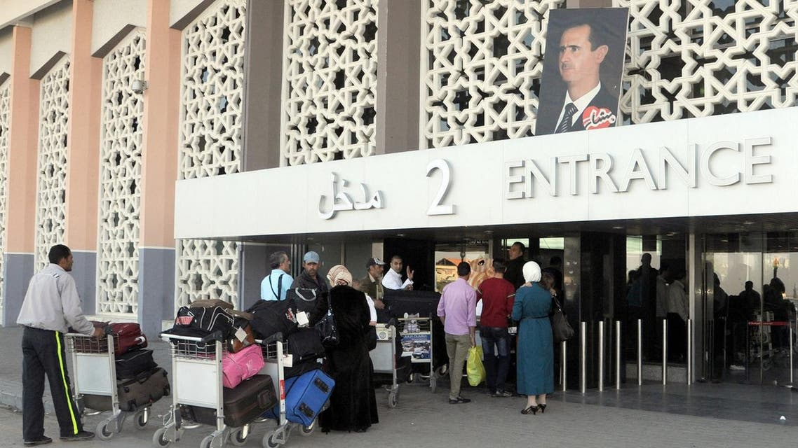 people arriving at the departures area of Damascus' international airport on April 14, 2013. (AFP)