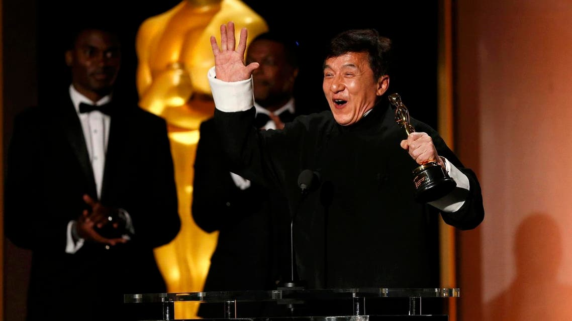 Actor Jackie Chan reacts as he accepts his Honorary Award as actor Chris Tucker (C) looks on at the 8th Annual Governors Awards in Los Angeles, California, U.S., November 12, 2016. REUTERS